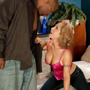 super-sexy granny Luna Azul seduces a younger ebony dude in satin lingerie and denim jeans on a bed