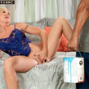 Sweet golden-haired granny Honey Ray has her youthful ebony lover blow her beaver and ass screw hole too