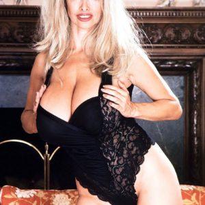 Tempting blonde Alexis Enjoy bares her hefty titties from black lingerie