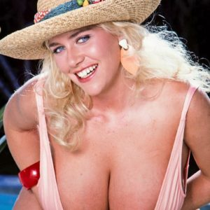 Top blonde XXX actress LA Burst looses her immense titties from swimsuit on poolside patio