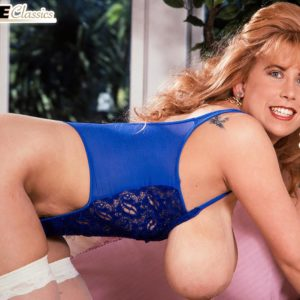 Well known X-rated starlet Tabatha Towers plays with her immense tits in milky hose