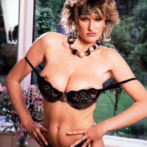 Aged MILF Debbie Q proudly demonstrates her amazing titties in ebony panties