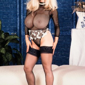 Blonde solo model Alexis Love holds her large boobies after unveiling them from see through top