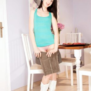 Boots wearing brown-haired first timer Lolly unsheathing tiny teener breasts and sumptuous butt in kitchen