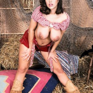 Brunette farm chick Carrie sets her humungous boobies loose in leather boots and cut-offs