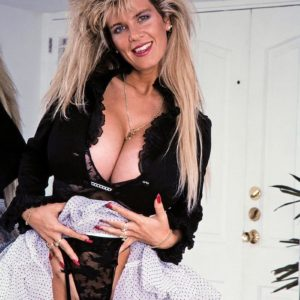 Legendary adult flick star Big-chested Dusty presses her humungous titties up against a mirror