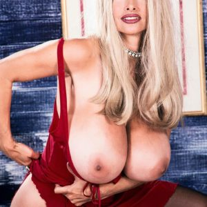 Notorious older XXX actress Alexis Enjoy lets her hefty boobs free in tights