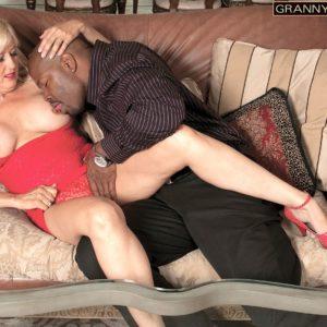 Platinum-blonde grandma Marina Johnson has her first multiracial sex experience in a crimson dress