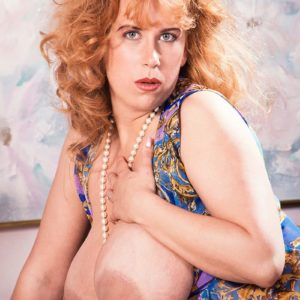 Red-haired MILF Tabatha Towers frees her hefty breasts in over the knee tights