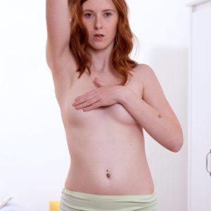 Redhead nubile solo chick Linda Seductive modeling naked for tease image shoot
