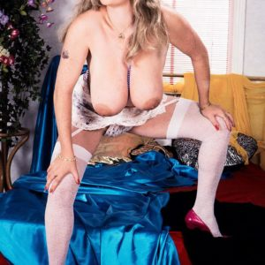 Solo chick Cathy Patrick extracts her giant breasts in milky nylons and garters