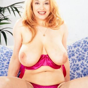 Stellar MILF Ruth Tyler puts her massive titties on show in see thru pantyhose and pumps