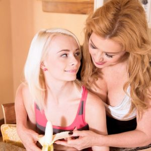 Teen lezzies Sasha Sean and Maddy Rose smooch while eating a banana in a SFW manner