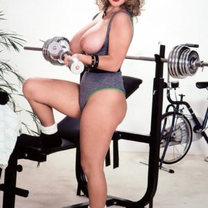 Well known senior XXX pornstar Tracy West uncorks her super-cute hooters on home gym equipment