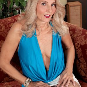 Expert light-haired lady Chery Leigh unsheathes her tits in tan nylons for her spouse