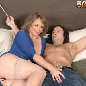 Mature yellow-haired doll Catrina Costa teases her corded up lover in hosiery and high heeled shoes