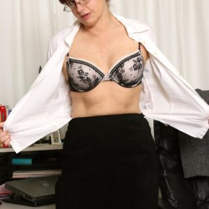 Older secretary makes her naked strutting debut while at work during solo act