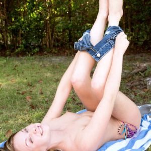 Puny teener Lizzy Bell loosing her smallish breasts from swimwear while outdoors in denim cut-offs