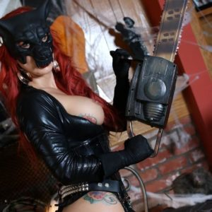 Solo model Karen Fisher exposes her giant boobs and ass from latex clothing at Halloween
