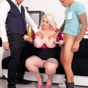 Plus-size yellow-haired assistant Kiki Rainbow pulls out her huge tits before stroking on 2 dicks