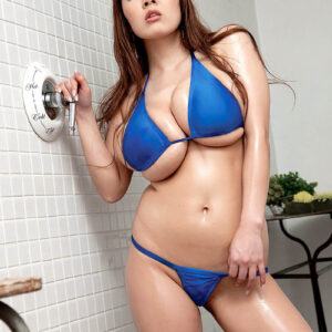 Japanese stunner Hitomi sports lengthy red hair while baring her hefty breasts from a bathing suit