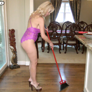 Busty platinum-blonde Victoria Lobov sweeps the floor in lingerie before tugging on a big cock