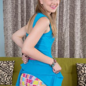 Beguiling nubile Lily Rader demonstrates her nice underwear before showing her little breasts