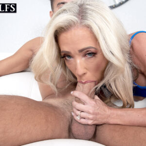 Platinum-blonde cougar Mandy Monroe tempts a younger man in a short sundress and high heeled shoes