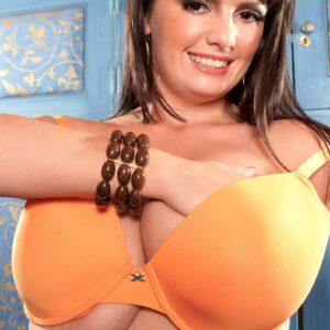 Huge jugged dark-haired fatty Arianna Sinn eats a nip during solo activities