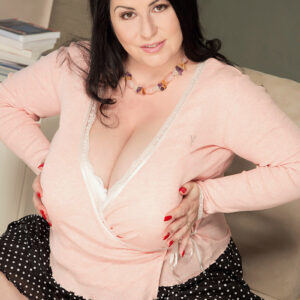 Black-haired pregger Natalie Fiore sets her giant titties free after an upskirt panty display