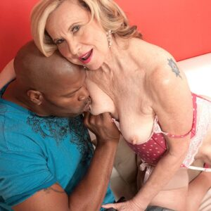 Smallish grandmother Miranda Torri has her hard nips played with by her younger black paramour