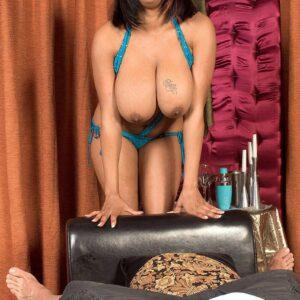 Black girl Carmen Hayes caressing her large adult movie starlet tits before nipple play begins