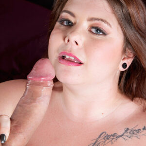 Red-haired fatty Harley Ann is liberated from a short dress before having sex with an immense penis