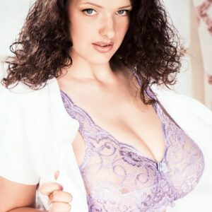 Brown-haired solo chick Olga unveils her fur covered slit after exposing her large boobies