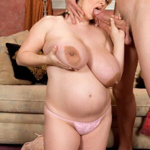 Big woman April McKenzie blows a massive cock after having her large boobies sucked upon