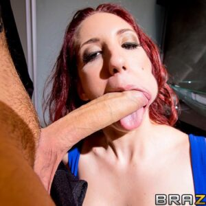 Red-haired MILF pornostar Kelly Divine gets ass boinked by a giant penis in black hose