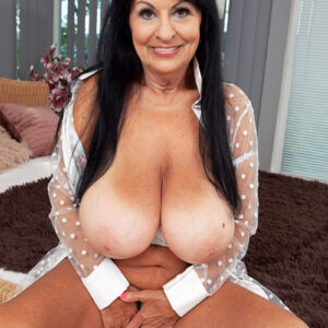 Massive boobed brown-haired grandmother Mona Marley unsheathes her tanned lined body before masturbating