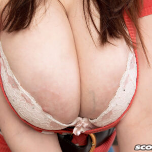 Stunner Sofie Style whips out her excellent tits in the kitchen before showing her gash