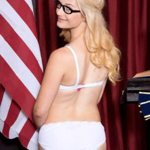 Glasses clad blond nubile Aubrey Gold disrobes down to hooter-slings and skivvies