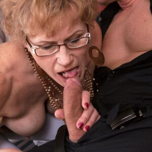 Grannie in glasses tempts a junior dude before deepthroating his cock on a futon