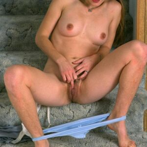Brunette first-timer revealing wooly pits and hairy pussy while disrobing