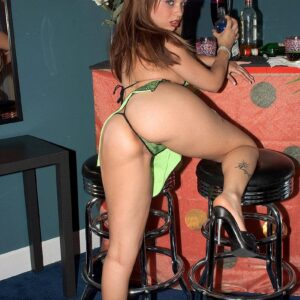 Latina MILF adult movie star Tia Sweets displaying huge butt in thong and high-heels