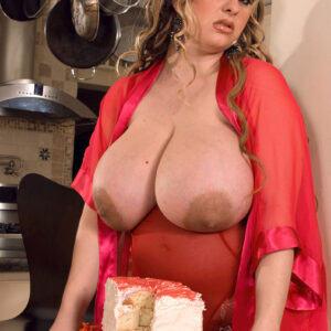 Gigantic jugged BBW April McKenzie gets on top of a cock while gobbling down slices of cake