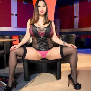 Hot MILF Tigerr Benson slides a thong aside prior to unsheathing her huge fake titties