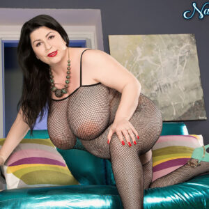 Preggie dark haired chick Natalie Fiore pulls her monster-sized titties out of a mesh bodystocking