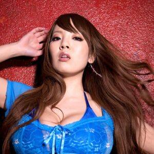 Redheaded Asian solo girl Hitomi sets her monster-sized titties loose before dispensing of a thong
