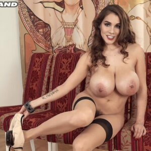 Tattooed solo model Mischel Lee releases her giant tits before losing her high cut underwear