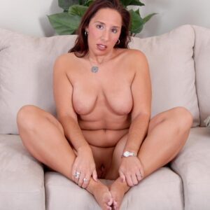 Experienced brown-haired doll does a slow striptease while removing a mini-skirt and high-heeled shoes