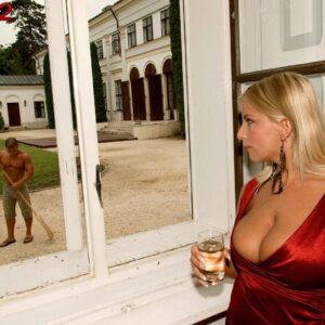 Platinum-blonde MILF Lucy Love releasing huge titties for breast slurping by a black man near a pool