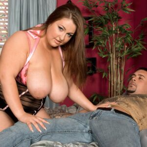 Big woman Hillary Hooterz has her massive boobs and derriere freed from sweet lingerie on a bed